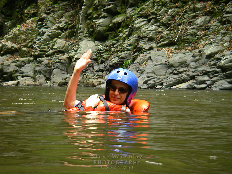 Smiling rafters floating in river, Chiriqui Viejo River, Panama