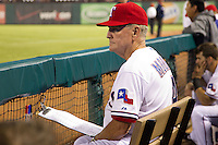 Texas Rangers coach Jackie Moore #4 in the dugout during the Major League Baseball game against the Baltimore Orioles on August 21st, 2012 at the Rangers Ballpark in Arlington, Texas. The Orioles defeated the Rangers 5-3. (Andrew Woolley/Four Seam Images).