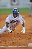 Kingsport Mets second baseman Yucary De la Cruz #1 slides into third during  a  game  against the Pulaski Mariners at Hunter Wright Stadium on August 9, 2011 in Kingsport, Tennessee. Kingsport won the game 2-1.   (Tony Farlow/Four Seam Images)