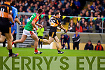 Michael Collins Austin Stacks in action against Danny O'Sullivan Mid Kerry in the Kerry Senior County Football Final at Fitzgerald Stadium on Sunday.