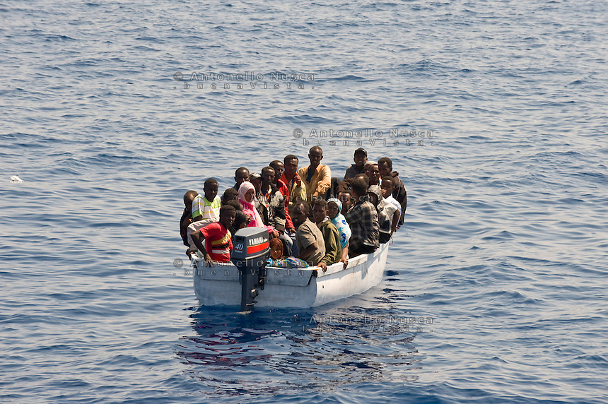 Una barca con a bordo clandestini provenienti dall'Africa e intercettata al largo dell'isola di Lampedusa..A boat carryng illegal immigrants from Africa.