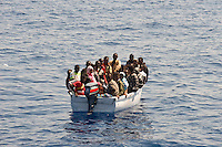 Una barca con a bordo clandestini provenienti dall'Africa e intercettata al largo dell'isola di Lampedusa..A boat carryng illegal immigrants from Africa.