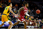 SIOUX FALLS, SD - MARCH 7: Ade Murkey #0 of the Denver Pioneers passes the ball against Tyson Ward #24 of the North Dakota State Bison at the 2020 Summit League Basketball Championship in Sioux Falls, SD. (Photo by Richard Carlson/Inertia)