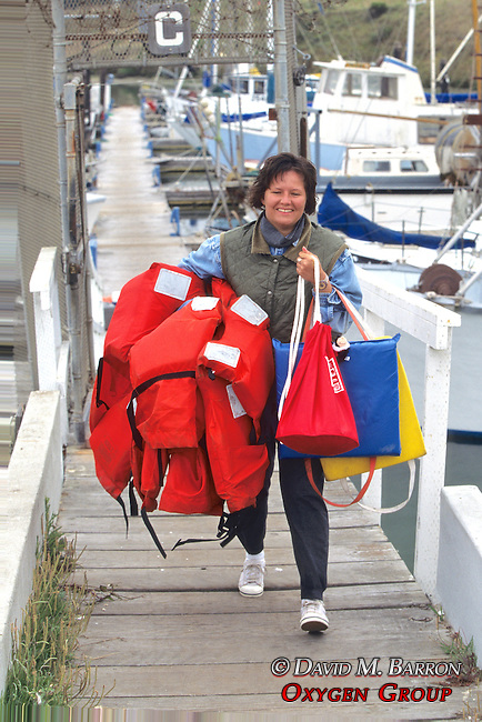 Claudia Willhoff Carrying Life Jackets