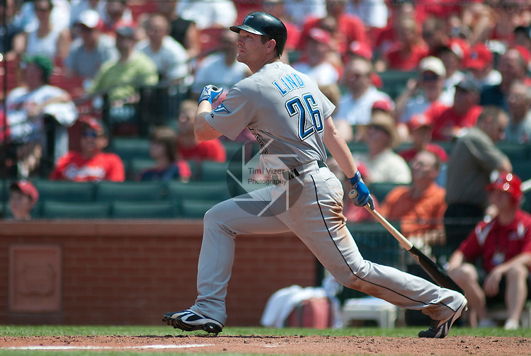 26 June 2011               Toronto Blue Jays first baseman Adam Lind (26) watches his hit.  The Toronto Blue Jays defeated the St. Louis Cardinals 5-0 in the final game of a three-game inter-league series on Sunday June 26, 2011 at Busch Stadium in downtown St. Louis.