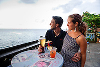 Montego Bay, Jamaica. Newlywed couple having drinks at Margaritaville Bar. Jamaica Tourism.