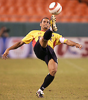 C.J. Brown kicks the ball during Kansas City's 1-0 victory over Chicago to win the US Open Cup, at Arrowhead Stadium, in Kansas City, MO, Wednesday, Sept., 22, 2004.