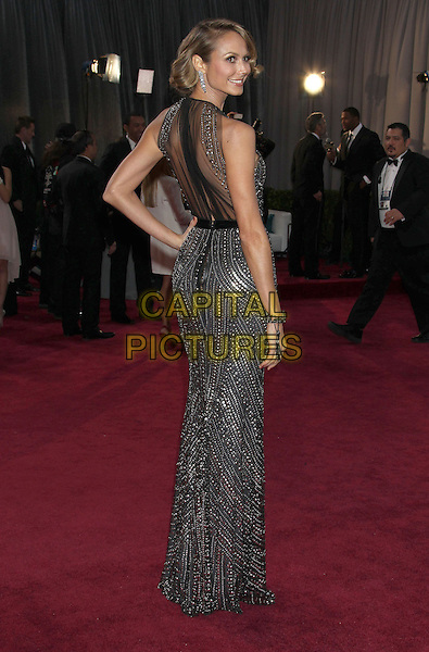 Stacy Keibler.85th Annual Academy Awards held at the Dolby Theatre at Hollywood & Highland Center, Hollywood, California, USA..February 24th, 2013.oscars full length black grey gray silver metallic sleeveless beads beaded dress belt hand on hip sheer back behind rear looking over shoulder .CAP/ADM/RE.©Russ Elliot/AdMedia/Capital Pictures.