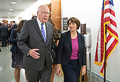 United States Senator Patrick Leahy (Democrat of Vermont), left, and United States Senator Amy Klobuchar (Democrat of Minnesota), right, converse in the hallway during a break in the testimony of Dr. Christine Blasey Ford  before the US Senate Committee on the Judiciary on the nomination of Judge Brett Kavanaugh to be Associate Justice of the US Supreme Court to replace the retiring Justice Anthony Kennedy on Capitol Hill in Washington, DC on Thursday, September 27, 2018.   <br /> Credit: Ron Sachs / CNP<br /> (RESTRICTION: NO New York or New Jersey Newspapers or newspapers within a 75 mile radius of New York City)
