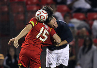 COLLEGE PARK, MD. - AUGUST 20, 2012:  Patrick Mullins (15) of  the University of Maryland tangles with Martin Seiler (22) of Penn State during an NCAA match at Ludwig Field, in College Park, Maryland on August 20. The game ended in a 2-2 tie.