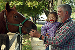 A horse gets greeted by Jenna Jenkins, age 3, and her grandfather, Myron Kenkins of Levittown, at Stolz Farm in Hicksville on Thursday October 20, 2005. (Newsday Photo / Jim Peppler).
