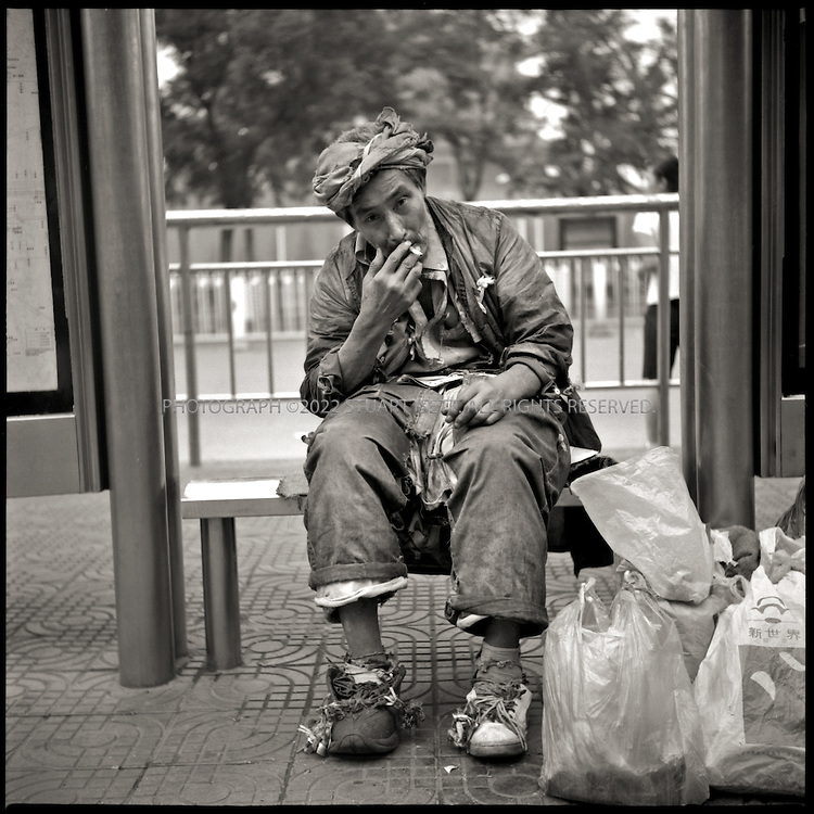 6/27/2005--Beijing, China..Ling Yin Long Jun, 52, a homeless man on the south side of Tiananmen Square..Photograph By Stuart Isett.All photographs ©2005 Stuart Isett.All rights reserved.