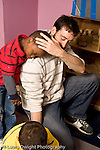 Education Preschool 4-5 year olds male student resting his head on male teacher's shoulder affectionate moment vertical
