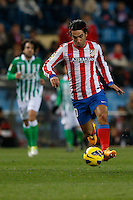 03.02.2013 SPAIN -  La Liga 12/13 Matchday 22th  match played between Atletico de Madrid vs Real Betis Balompie (1-0) at Vicente Calderon stadium. The picture show  Arda Turan (Turkish midfielder of At. Madrid)