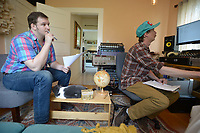 NWA Democrat-Gazette/ANDY SHUPE<br /> Willi Carlisle (left), a poet, songwriter, musician and playwright, works Friday, April 13, 2018, on his second album with Eric Witthans, owner of Homestead Recording in Fayetteville.