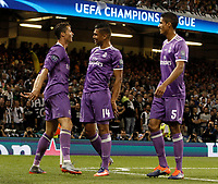 Calcio, Champions League: finale Juventus vs Real Madrid. Cardiff, Millennium Stadium, 3 giugno 2017.<br /> Real Madrid's Cristiano Ronaldo, left, celebrates with his teammates Casemiro, center, and Raphael Varane, after scoring during the Champions League final match between Juventus and Real Madrid at Cardiff's Millennium Stadium, Wales, June 3, 2017. <br /> UPDATE IMAGES PRESS/Isabella Bonotto