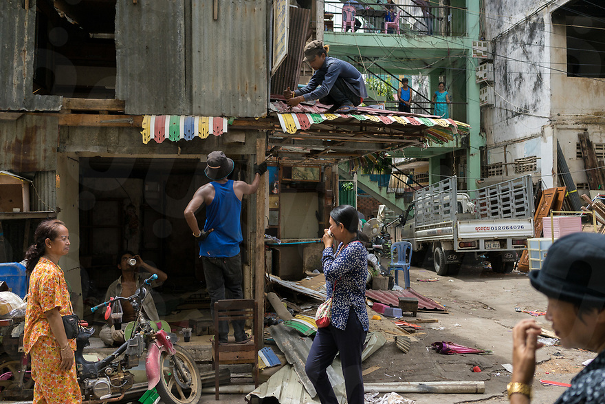 June 10, 2017 - Phom Penh (Cambodia). People dismantle a roof from one of the shops built in front of the White Building. After months of negotiation most of the families living in here received a compensation and the iconic building from the '60 will be demolished to make space to a new condo. © Thomas Cristofoletti / Ruom