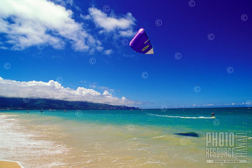 A Maui kitesurfer on the North Shore at Kanaha Beach