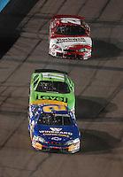 Apr 20, 2007; Avondale, AZ, USA; Nascar Busch Series driver Clint Bowyer (2) leads Matt Kenseth (17) and Denny Hamlin (20) during the Bashas Supermarkets 200 at Phoenix International Raceway. Mandatory Credit: Mark J. Rebilas
