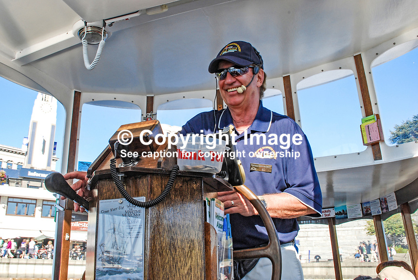 Skipper of one of the many Victoria Harbour Ferry boats that are a big tourist attraction. They potter around the harbour with a maximum of 12 passengers. The skipper doubles as a tour guide, Victoria, British Columbia, Canada, 200809131387..Copyright Image from Victor Patterson, 54 Dorchester Park, Belfast, UK, BT9 6RJ..Tel: +44 28 9066 1296.Mob: +44 7802 353836.Voicemail +44 20 8816 7153.Skype: victorpattersonbelfast.Email: victorpatterson@mac.com.Email: victorpatterson@ireland.com (back-up)..IMPORTANT: If you wish to use this image or any other of my images please go to www.victorpatterson.com and click on the Terms & Conditions. Then contact me by email or phone with the reference number(s) of the image(s) concerned.