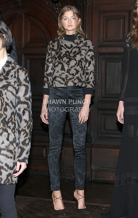 "Model Georgie poses in a leopard mohair jacquard sweatshirt and black brocade floral jacquard high waist slim tux trouser, from the Veronica Beard Fall 2016 ""Gypsy Caravan"" collection presentation, at the Highline Hotel on February 15 2016, during New York Fashion Week Fall 2016."