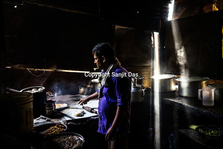 A chef prepares parantha (indian bread) at a roadside restaurant along the Jammu Srinagar highway in Jammu and Kashmir, India.