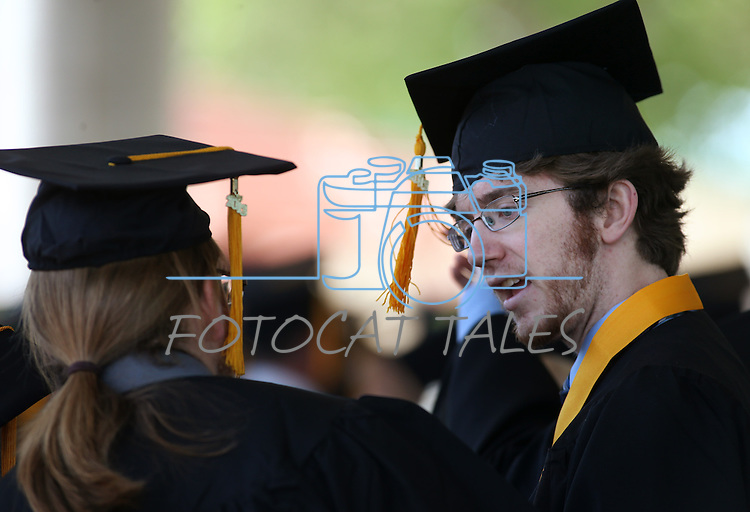 Nicholas Thornhill, left, and Kyle Flanagan talk before the 2013 Western Nevada College Commencement at the Pony Express Pavilion, in Carson City, Nev., on Monday, May 20, 2013. .Photo by Cathleen Allison