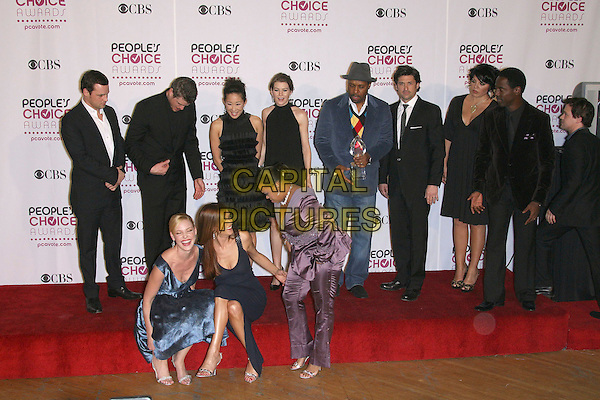 GREY'S ANATOMY CAST.The 33rd Annual People's Choice Awards - Press Room held at The Shrine Auditorium, Los Angeles, California, USA..January 9th, 2007.full length sitting black blue purple hat award trophy.CAP/ADM/ZL.©Zach Lipp/AdMedia/Capital Pictures