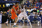 12 March 2015: Miami's James Palmer (left) is guarded by Notre Dame's Jerian Grant (22). The Notre Dame Fighting Irish played the University of Miami Hurricanes in an NCAA Division I Men's basketball game at the Greensboro Coliseum in Greensboro, North Carolina in the ACC Men's Basketball Tournament quarterfinal game. Notre Dame won the game 70-63.