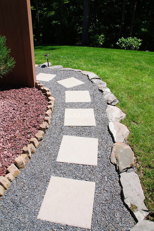 Red Stones For Garden Walkway pathway made of stone plant flower stock photography garden path simple stones set into gravel edged with stones near lush green workwithnaturefo