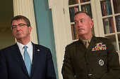 United States Secretary of Defense Ashton Carter, left, and Chairman of the Joint Chiefs of Staff General Joseph Dunford look on as US President Barack Obama as he makes a statement after meeting with his National Security Council at the State Department, February 25, 2016 in Washington, DC. The meeting focused on the situation with ISIS and Syria, along with other regional issues. <br /> Credit: Drew Angerer / Pool via CNP