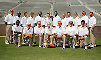 TALLAHASSEE, FL. 8/9/09-FSU-COACHES 0809 CH01-Florida State Football Coach Bobby Bowden, front row, center, is surrounded by his coaching staff during media day Sunday in Tallahassee...COLIN HACKLEY PHOTO