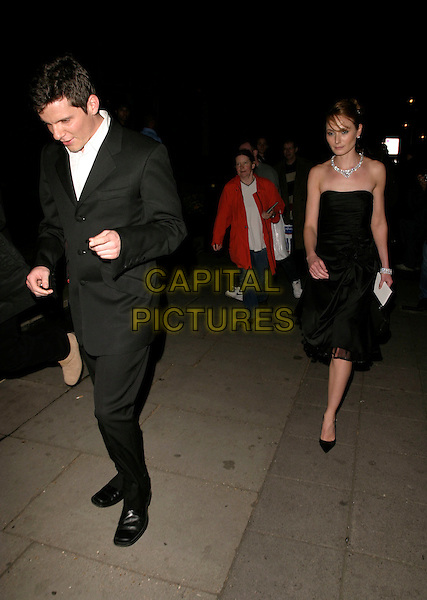 NIGEL HARMAN & GUEST.Leaving the British Academy Television Awards (Bafta's),.Grosvenor House Hotel, London, England, May 7th 2006..bafta baftas full length head down.REf: AH.www.capitalpictures.com.sales@capitalpictures.com.©Adam Houghton/Capital Pictures.
