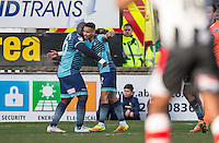Adebayo Akinfenwa congratulates winning goal scorer Paris Cowan-Hall of Wycombe Wanderers as he makes it 2 1 during the Sky Bet League 2 match between Grimsby Town and Wycombe Wanderers at Blundell Park, Cleethorpes, England on 4 March 2017. Photo by Andy Rowland / PRiME Media Images.