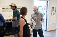 Photographer Bear Guerra.<br /> Opening Reception for South of Fletcher: Stories from the Bowtie, Sept. 13, 2018 at the Weingart Gallery. South of Fletcher: Stories from the Bowtie is a multi-platform storytelling project by Fonografia Collective, produced by Clockshop. Ruxandra Guidi and Bear Guerra have been working at the Bowtie parcel for the past year, talking to people who frequent the site, and learning more about the historic, present day, and potential uses of this unique plot of land next to the LA River. Their research will unfold through a podcast series, three public discussions, and an exhibition of photography at Occidental College. Sponsored by Oxy Arts.<br /> (Photo by Marc Campos, Occidental College Photographer)