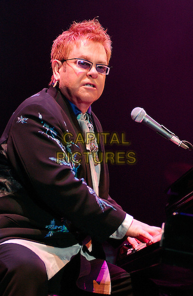 """SIR ELTON JOHN.performs as a part of his """"The Captain & The Kid Tour""""  held at the Mellon Arena.  Pittsburgh, Pennsylvania, USA,.06 October 2006..concert music gig on stage live half length playing piano .Ref: ADM/JN.www.capitalpictures.com.sales@capitalpictures.com.©Jason L Nelson/AdMedia/Capital Pictures."""