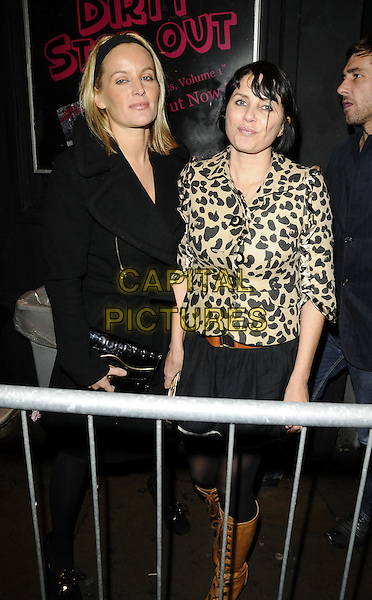 DAVINIA TAYLOR & SADIE FROST.The Agent Provocateur Pirate Extravaganza party, Koko, Camden Town, London, England..November 13th, 2008.full length black coat jacket leopard print skirt brown lace up boots headband.CAP/CAN.©Can Nguyen/Capital Pictures.