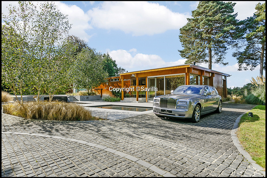 BNPS.co.uk (01202 558833)<br /> Pic: Savills/BNPS<br /> <br /> Sadly the Rolls Royce is extra...<br /> <br /> Perfect home for a Bond villan...designed by a Bond villan!<br /> <br /> This stunning 1960's modernist masterpiece near Windlesham in Surrey was actually designed by Hungarian architect Erno Goldfinger - who bizarrely author Ian Fleming had based one of his most notorious James Bond villans on.<br /> <br /> Fleming was furious with Goldfinger after the architect had demolished his Hampstead cottage to make way for a modernist development before the war.<br /> <br /> But at £3 million you may need your own gold reserves to afford the stunning grade two listed home, and with 4 acres of grounds an 'Oddjob' man may come in handy to look after it.