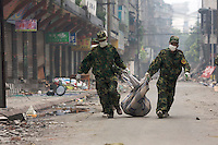 Soldiers carry out rotten dead body from a residential compound in Puyang Road, Dujiangyan on the fifth day after the 7.8 magnitude earthquake, 25 dead bodies were found so far. The earthquake happened at 14:28pm on 12 May 2008, with the epicenter in Wenchuan County, about 159km NW of Chengdu, Sichuan, China..18 May 2008