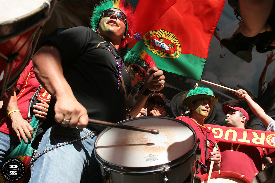 Portugese fans carry and beating drums inside the main hall of the Cologne train station in Cologne, Germany.  The fans were getting ready for the Portugal national soccer team's first round FIFA World Cup match against Angola in Cologne, Germany on Sunday, June 11th 2006.