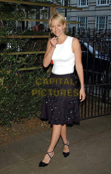 ELIZABETH MURDOCH.Mercedes-Benz launch of new Maybach car and Tatler magazine summer party in Portman Square..www.capitalpictures.com.sales@capitalpictures.com.©Capital Pictures.cross-over heels, full skirt, black and white.