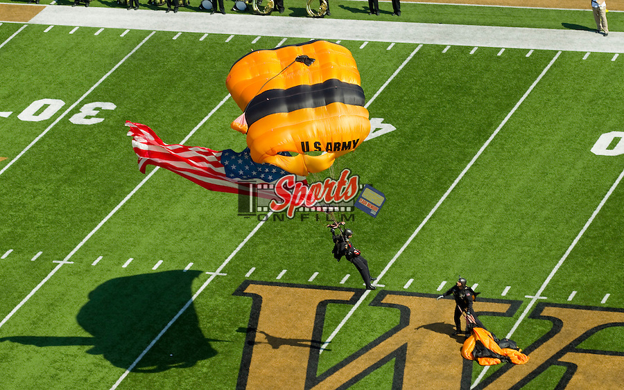 WINSTON SALEM, NC - SEPTEMBER 22: A member of the U.S. Army Golden Knights parachutes onto the field with the American Flag prior to the game between the Army Black Knights and the Wake Forest Demon Deacons at BB&T Field on September 22, 2012 in Winston Salem, North Carolina.  The Demon Deacons defeated the Black Knights 49-37.  (Photo by Brian Westerholt/Sports On Film)