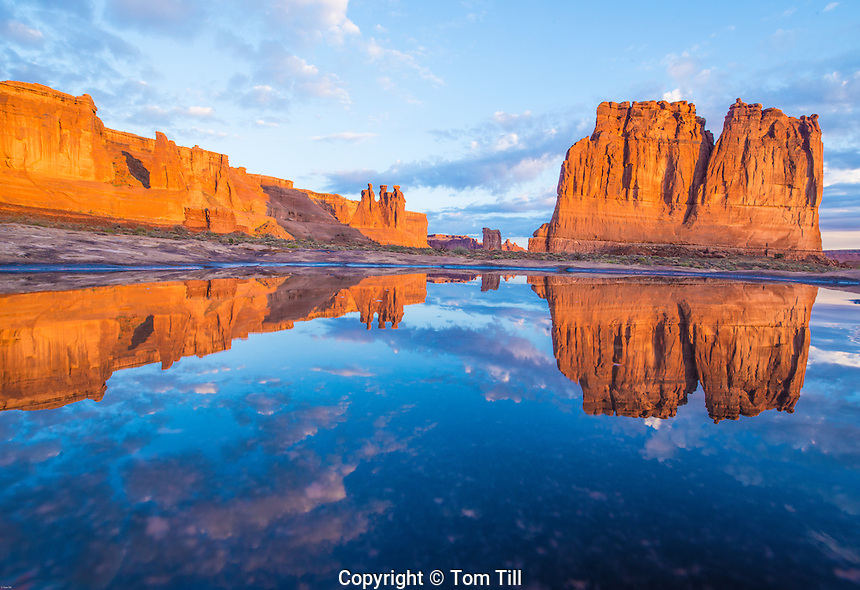 Courthouse Towers reflected in rain pool. Arches National Park, Utah The Organ, Sheep Rock, and Three Gossips