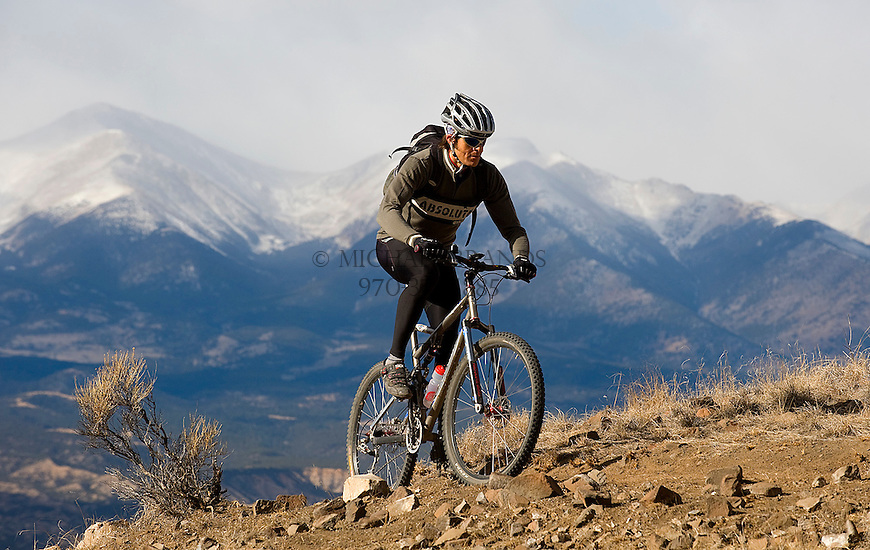 "Salida resident Eric Tauer breaks away from work for a lunchtime ride up ""Li'l Rattler"" a new single track trail for hikers and mountain bikers on the outskirts of town. In the background is the Sawatch mountain range. Michael Brands for The New York Times."