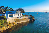 BNPS.co.uk (01202 558833)<br /> Pic: LillicrapChilcott/BNPS<br /> <br /> Stunning location...<br /> <br /> A brand new futuristic property perched right on the edge of a sea wall overlooking some of the finest sailing waters in the country has gone up for sale for £4.5m.<br /> <br /> The ultra-modern home and just been built on remote headland in the Cornish sailing village of St Just.<br /> <br /> It replaced a large bungalow that stood on the coastal plot for over 80 years and was demolished by owner and architect Callum Wason.