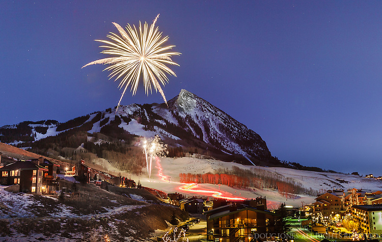 A real American Landscape!  Fireworks begin as the Torchlight Parade finishes at the base of Mt Crested Butte.  I shot this just after dusk in 13 degree weather from the third floor balcony of a condo my family and I were staying in.  I only had one chance to capture the whole scene.