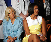 United States First Lady Michelle Obama and Dr. Jill Biden attend an event about the Affordable Care Act at George Washington University Hospital, on Wednesday, July 14, 2010, in Washington, DC.  .Credit: Leslie E. Kossoff - Pool via CNP