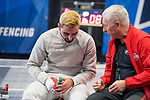 UNIVERSITY PARK, PA - MARCH 25: Domenik Koch of Ohio State University talks with Head Coach Vladimir Nazlymov during the semifinals of the saber competition during the Division I Men's Fencing Championship held at the Multi-Sport Facility on the Penn State University campus on March 25, 2018 in University Park, Pennsylvania. (Photo by Doug Stroud/NCAA Photos via Getty Images)