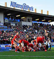 Hendon, England. Felix Jones of Munster clears the ball during the European Rugby Champions Cup match between Saracens and Munster at Allianz Park stadium on January 17, 2015 in Hendon, England.