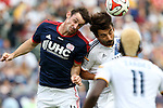 07 December 2014: New England's Andy Dorman (left) and Los Angeles's Baggio Husidic (right) challenge for a header. The Los Angeles Galaxy played the New England Revolution in Carson, California in MLS Cup 2014. Los Angeles won 2-1 in overtime.
